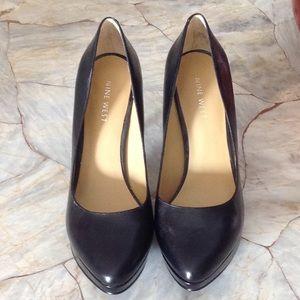 Black high heel pumps